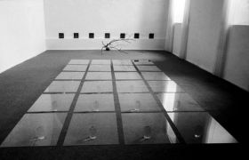 Florence A. Neal: Alchemical balance — glass plates, bottles and water (1993). Photographer: archive